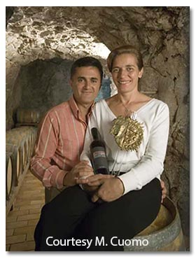 Marisa and Andrea in their wine cellar