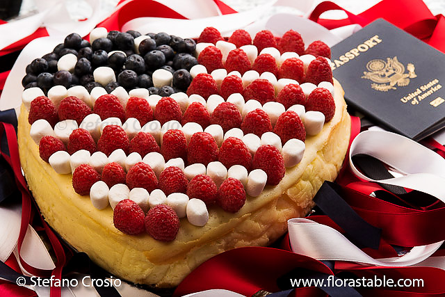 Heart-shaped patriotic cheesecake with raspberries, blueberries and mini marshmallows